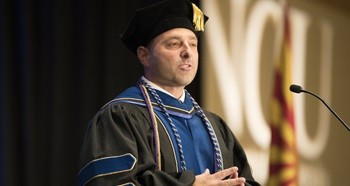 Alumni of the year, Dr. Mike Clumpner speaks at NCU graduation
