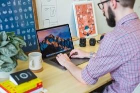 Instructional designer sitting at computer