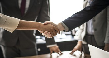 People shaking hands at a job interview